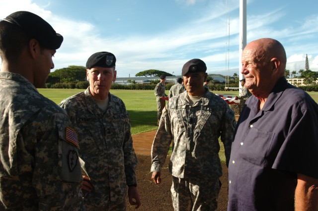 "Former CSA and CG current AUSA President, Army Gen. retired Gordon R. Sullivan (right) and 25th Inf. Div. leadership speak with Sgt. Juan Reyes, a bugler for the Division Band, following the ""Retreat"" ceremony during his visit to Schofield Barracks, Hawaii, Sept. 14. Sullivan visited the many military posts on-island and met with many Soldiers and their families. (U.S. Army photo by Lt. Col. Sean Wilson, 25th Infantry Division Public Affairs Office)"