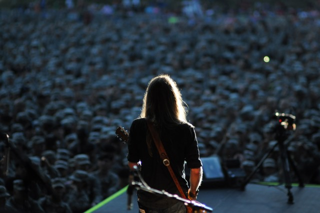 Charlie Starr, singer and guitarist for the band Blackberry Smoke, scans the crowd of uniformed Soldiers gathered in front of the stage on Hilton Field Saturday. The Atlanta-based Southern rock band opened for Kid Rock.