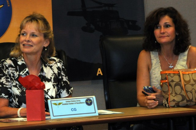 Kimberly Crutchfield, left, wife of Brig. Gen. Anthony G. Crutchfield, USAACE and Fort Rucker commanding general, and Leslie Edens, wife of Col. Timothy Edens, USAACE Deputy Commander, sit in on the senior spouses meeting at the Bldg. 101 regimental conference room Sept. 7. This is Crutchfield's first senior spouses meeting. The Crutchfields recently arrived here and say they want to gain feedback from Soldiers and Families to improve quality of life.