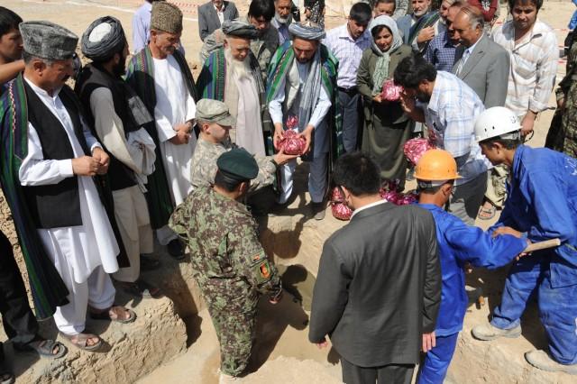 1st BSTB Soldiers help break ground at local school