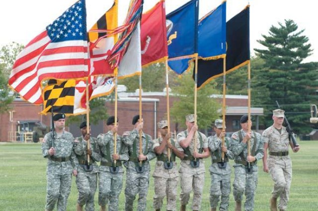 The Joint Service Color Guard marches onto Fanshaw Field during the Aberdeen Proving Ground 9/11 Remembrance Ceremony Sept. 10. From left, Sgt. Christopher Ruzicka, Staff Sgt. Jenise Phillips, Spc. Jonathan Cremeen, Sgt. Daniel Kershner, USMC Sgt. Osvaldo Santillan, USMC Staff Sgt. Ron Meak, USAF Sgt. Daniel Kershner, Sgt. James Blakeley; and USMC Cpl. Donald Ratts.