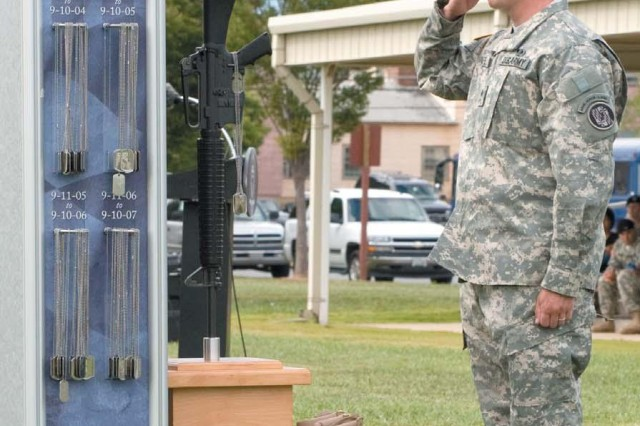 Sgt. 1st Class Brian Paape of the Maryland National Guard renders a salute after placing a set of ID tags on the Fallen Heroes Monument during the 9/11 Remembrance Ceremony at Fanshaw Field Sept. 10.