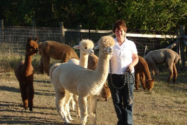 Price and one of her alpacas.