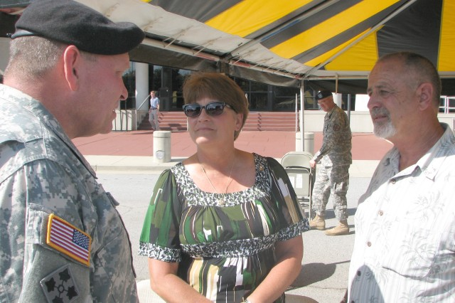 The U.S. Army Forces Command (FORCOM) commanding general, Gen. James Thurman, talks with Pat and Kathy McCloskey, parents of Sgt. 1st Class Shawn McCloskey, a Peachtree City native who was killed by a roadside bomb Sept. 16, 2009, in Afghanistan, after FORSCOM's Patriot Day ceremony. The Family placed a wreath outside FORSCOM headquarters in remembrance of the Sept. 11, 2001, terror attacks.