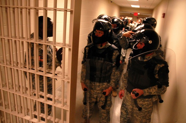 Sgt. 1st Class Joseph Williams, Headquarters and Headquarters Company, Joint Regional Correctional Facility, gives last-minute instruction as a hasty reaction force prepares to enter the dining facility where a mock hostage situation is taking place during training Sept. 9 at the JRCF, Fort Leavenworth, Kan. Soldiers who will be working in the facility trained on emergency action plans for a variety of scenarios while executing normal daily operations.