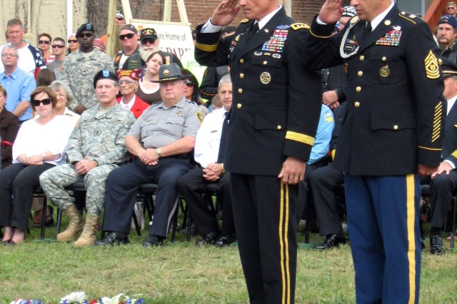 Lt. Gen. Robert L. Caslen Jr., commanding general of the Combined Arms Center and Fort Leavenworth, Kan., and CAC Command Sgt. Maj. Philip Johndrow salute the wreath they placed at the Veterans of Foreign Wars Park in Leavenworth to honor fallen Soldiers from Sept. 11, 2001, to present during a ceremony Sept. 11. Caslen and other Kansas leaders spoke to a crowd of more than 300 people as part of a 9/11 remembrance ceremony in Leavenworth.