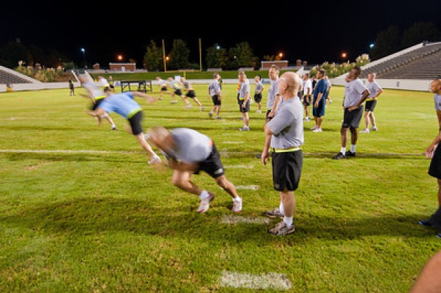 The sergeants major, to include SMA Kenneth Preston,  do sprints during early morning physical training Tuesday on the football field at South Commons Memorial Park in Columbus.