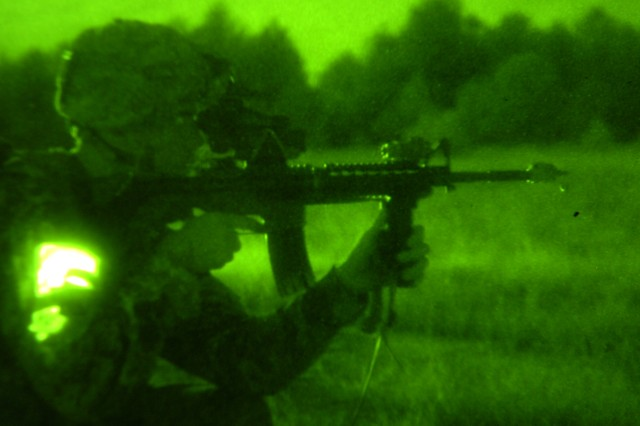 With an infrared light glowing from his pocket, a Paratrooper with the 2nd Brigade Combat Team, 82nd Airborne Division scans the surrounding wood-line through his night-vision goggles for enemy combatants, during the 2BCT's joint forcible entry exercise, Sep., 14. (U.S. Army Photo by Staff Sgt. Seth Laughter, 2BCT PAO NCOIC)