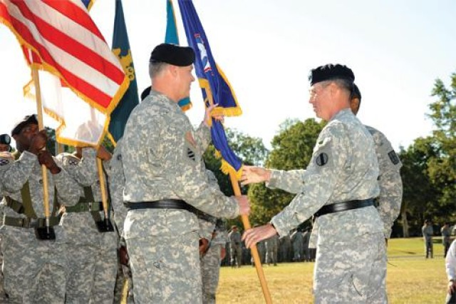 Maj. Gen. James L. Hodge, incoming Combined Arms Support Command and Sustainment Center of Excellence commanding general, receives the CASCOM and SCoE guidon from Lt. Gen. John E. Sterling, Training and Doctrine Command deputy commanding general and chief of staff, during a Sept. 9 change of command ceremony at Fort Lee's Williams Stadium.