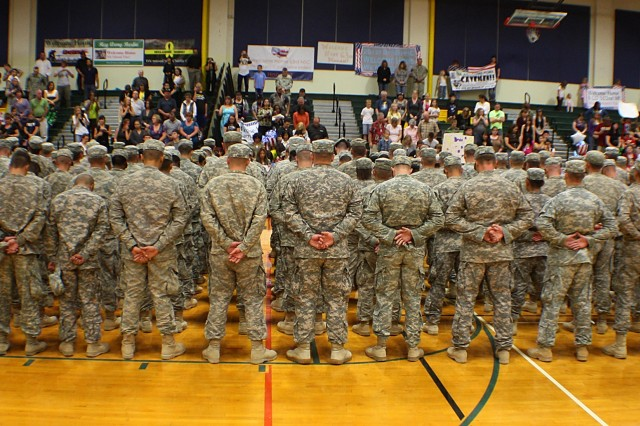 Nearly 250 Soldiers from 201st Battlefield Surveillance Brigade wait to be reunited with their families and friends at a ceremony at Soldiers Field House on Joint Base Lewis-McChord Sept. 13.