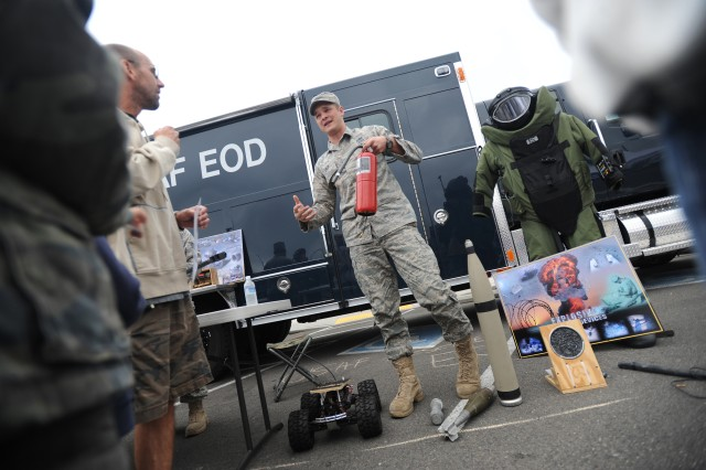 Senior Airman Veejay Lach with the 62nd Civil Engineering Squadron, talks about his job as a explosives ordnance technician Sept. 11 at the 8th Annual Military Family Support Day in Lacey.