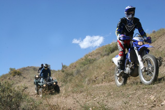 FORT CARSON, Colo.-Eric Hill, Outdoor Recreation director, leads two all-terrain vehicle riders on one of the many trails that make up the new Fort Carson Off Highway Vehicle Park Sept. 10 following the grand opening.