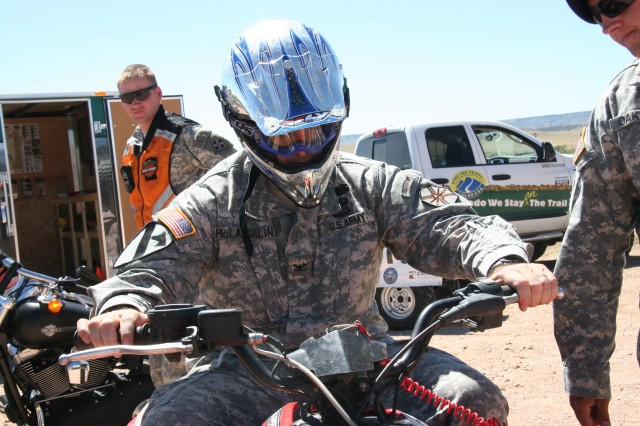 FORT CARSON, Colo.-Fort Carson Garrison Commander Col. Robert F. McLaughlin prepares for his first all-terrain vehicle ride Sept. 10 following the Fort Carson Off Highway Vehicle Park grand opening.