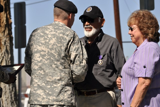 Fort Irwin Garrison Commander Col. James H. Chevallier shakes hands with Mr. David Villafana as his wife, Lydia, looks on during Fort Irwin and the National Training Center's POW/MIA National POW/MIA Day ceremony on Sept. 17, 2010.