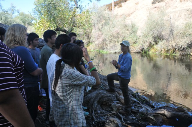 <b>NEW HOGAN LAKE, Calif.</b> -- Kari Burr (right), senior biologist with the Fishery Foundation of California, teaches students from A.A. Stagg Senior High School about the ecology of the Calaveras River during Calaveras River Education and Appreciation Day here Sept. 11. The event, paid for through a grant from the U.S. Fish and Wildlife Service's Connecting People with Nature program, was designed to help students understand connections between the river's watershed and ecosystem, and the human relationship to it.