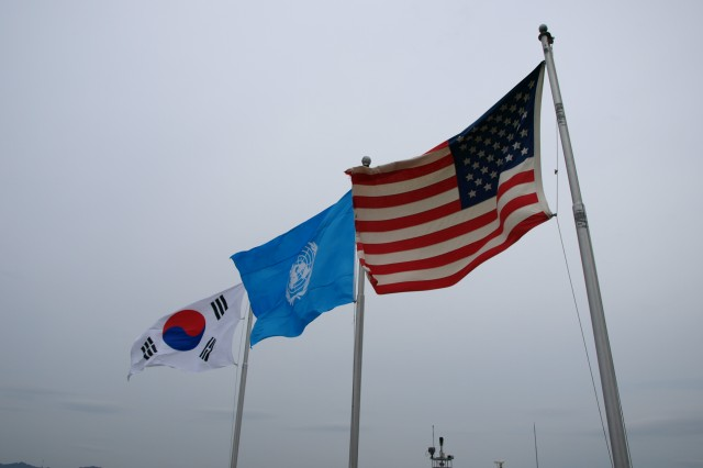 Flags representing the Republic of Korea, the United Nations and the United States of America, fly above Observation Post Ouellette at the Demilitarized Zone that separates South and North Korea.