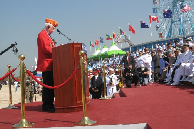 William Cheek, a Marine who served during the Korean War, recalls his experiences during a Sept. 15, 2010, ceremony commemorating the 60th anniversary of the Inchon Landing. Cheek is among U.S. Korean War veterans participating in the Korea Visit Program.
