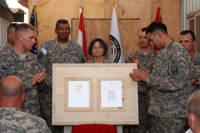 From left, Maj. Gen. Vincent Brooks, the United States Division – South commanding general, Lt. Col. Pamela Breedlove, the Combat Stress Clinic commanding officer, and Capt. Lloyd Sporluck, commander of Battery A, 5th Battalion, 5th Air Defense Artillery Regiment,  unveil the placard dedicating the facility to Sgt. Brandon Maggart Sept. 10.