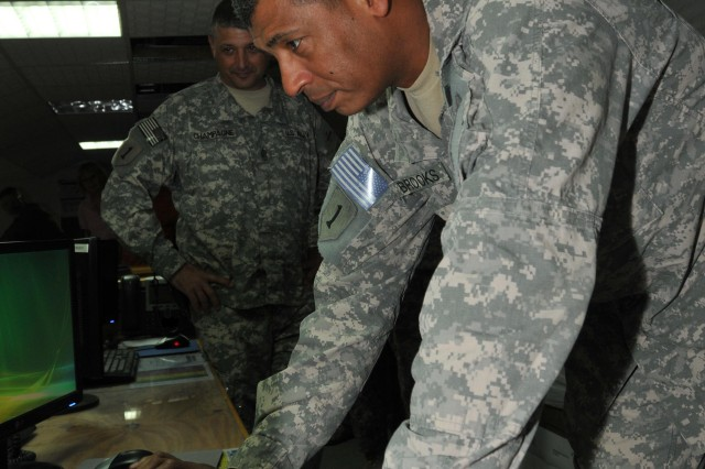 Maj. Gen. Vincent Brooks, commanding general of the 1st Infantry Division and United States Division-South, starts up the Command Post of the Future Battle Command 10 at the 1st Inf. Div. headquarters in Basra, Iraq, Sept. 11. The 'Big Red One' is the first operational unit in Iraq to receive the communications upgrade.
