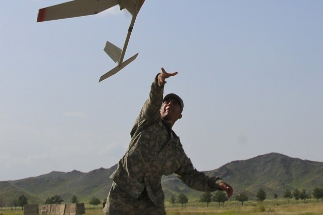 KHOWST PROVINCE, Afghanistan - U.S. Army Spc. Marcos Nino, radio operator, Company A, 1st Battalion, 187th Infantry Regiment, from Dallas, launches a Raven remotely piloted aircraft on Forward Operating Base Salerno during a recent test flight. The small RPA provides aerial battlefield surveillance and reconnaissance for the company commander. (Photo by U.S. Army Sgt. Brent C. Powell, 3rd Brigade, 101st Airborne Division)