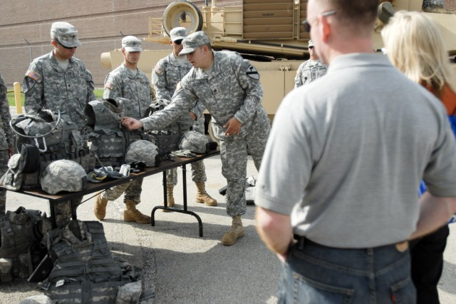 FORT HOOD, Texas-Sgt. Stephen Daniel, a fire support non-commissioned officer with 3rd Brigade Combat Team, 1st Cavalry Division, explains the use of the Improved Outer Tactical Vest to participants of the Central Texas Community Leader's Day, Sept.