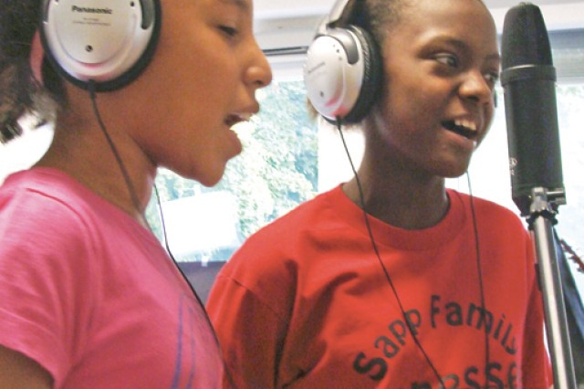 "Shailen Hinson and Kambria Price record the vocals for ""Turn the Lights Out,"" an Energy Star and Boys and Girls Clubs of America Partnership project meant to encourage energy conservation among garrison youths."
