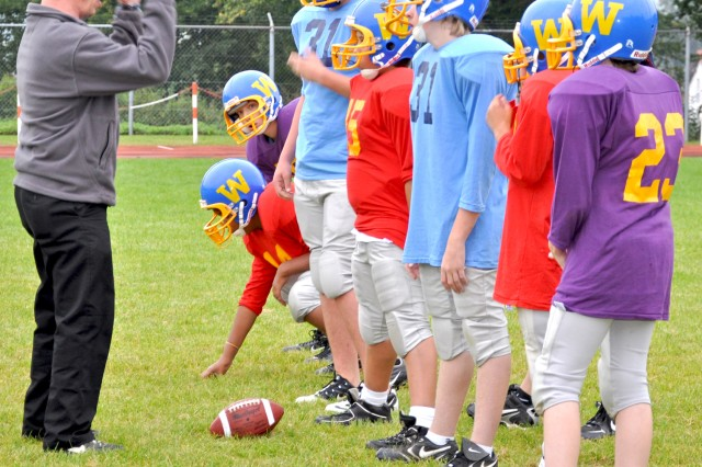Coach Peter Witmer describes a play to his Wiesbaden players.