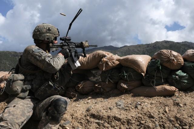Forward observer fires at insurgents