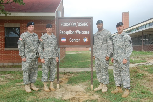 Leaders from U.S. Army Reserve Command's forward element at Fort Bragg, N.C., pose for a photograph, Aug. 20, 2010, at the FORSCOM/USARC Reception & Welcome Center.  Active and Reserve Component Soldiers assigned to the headquarters of U.S. Army Forces Command or USARC report here after completing installation processing with the Fort Bragg Reception Company.  Pictured are (L-R) FORSCOM/USARC Special Troops Battalion executive officer, Maj. Bill Clark; Col. Timothy Collins, USARC deputy chief of staff; Capt. Roger Williams, company commander  and 1st Sgt. Blaine Huston of Headquarters and Headquarters Company, USARC.