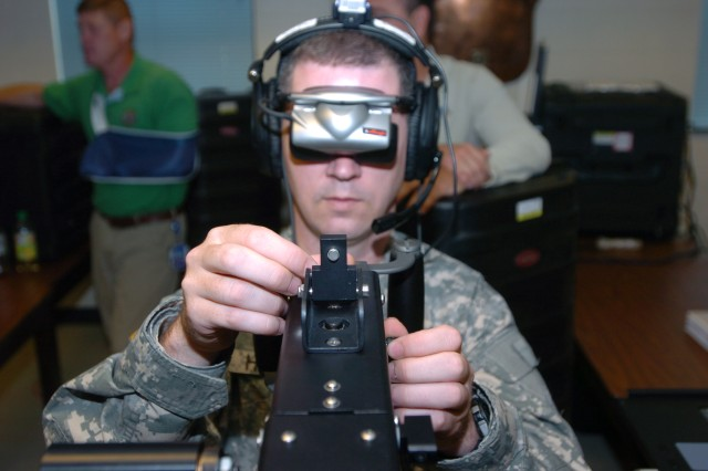 Sgt. Peter Hyland, the unit administrator for 1st Detachment, Headquarters and Headquarters Company, 27th Brigade Special Troops Battalion, practices the fine adjustments of the new .50-caliber individual gunnery trainer on Sept. 15, 2010, at the 27th Brigade Armory.