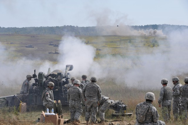 155mm artillery round shoots out of the M-198 155mm Towed Howitzer signifying the last time the cannon will be shot by the Indiana National Guard. The 2nd Battalion, 150th Field Artillery crew fired the M-198 during a historic retirement ceremony at Camp Atterbury Joint Maneuver Training Center, Ind., Sept. 18, 2010.