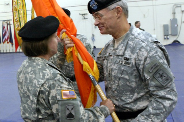 Department of the Army Staff's Chief Information Officer, G-6, Lt. Gen. Jeffrey Sorenson, right, passes the flag to Brig. Gen Jennifer Napper during a change of command ceremony, today.