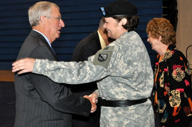 Maj. Gen. Susan S. Lawrence, outgoing commander, greets retired Maj. Gen. James Hylton, former Network Enterprise Technology Command/9th Signal Command (Army) commander, at the end of the change of command ceremony Sept. 22 at Barnes Field House, Fort Huachuca, Ariz.