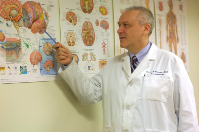 Dr. David Williamson, medical director for the Inpatient Psychological Heath and Traumatic Brain Injury program at the National Naval Medical Center in Bethesda, Md., and his staff are breaking new ground in identifying and treating traumatic brain injuries and mental-health issues.