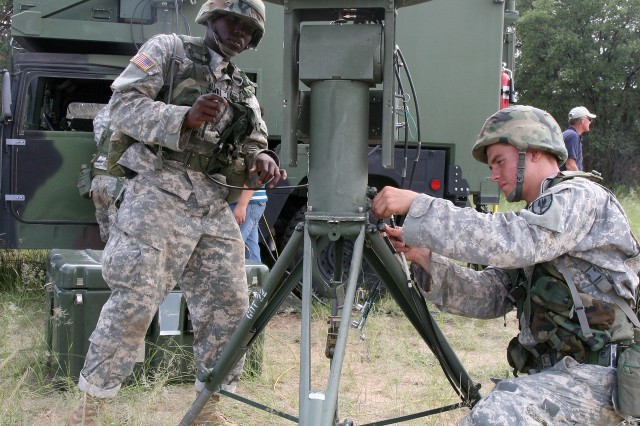 From left, Pfc. Andrew Stamps and Pvt. Jonathon Sweeney of Company A, Unmanned Aircraft System Training Battalion, work on the ground data terminal Aug. 31, during a week-long field training exercise on Fort Huachuca.