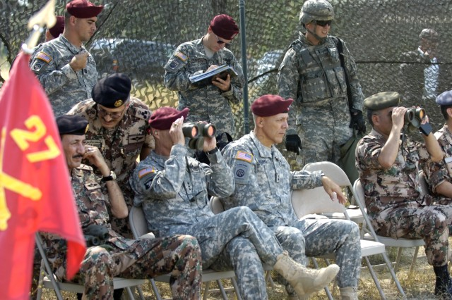 FORT BRAGG, N.C.- Lt. General Mashal M. Al-Zaben, Jordanian Chairman of the Joint Chiefs of Staff (left, front row), Lt. Gen. Frank Helmick, XVIII Airborne Corps commander, Maj. Gen. James L. Huggins, 82nd Airborne Division commander and Brig. Gen Mohammed Salem Jaradat watch a HIMARS demonstration on Sep. 23 on Fort Bragg's Nijmegan Drop Zone. (U.S. Army photo by Staff Sgt. Andrew T. Alfano,  82nd Airborne Public Affairs)