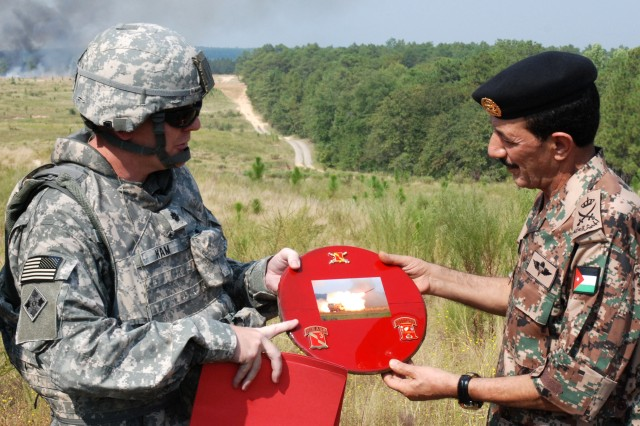 FORT BRAGG, N.C.- Lt. Col. Thomas B. Ham, commander of 3rd Battalion, 27th Field Artillery Regiment, 18th Fires Brigade, 82nd Airborne Division presents Lt. Gen. Mashal M. Al-Zaben, the Chairman of the Joint Chiefs of Staff in Jordan,  a special rocket pod cover as a memento for a HIMARS live fire Sep. 23, on Fort Bragg's Nijmegan Drop Zone. (U.S. Army photo by Staff Sgt. Andrew T. Alfano, 82nd Airborne Public Affairs)
