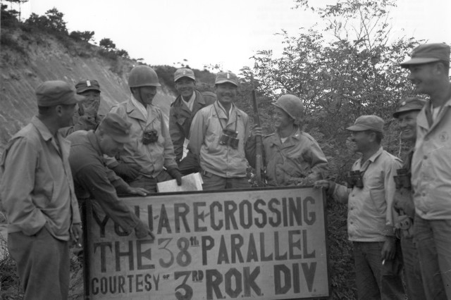 U. S. Army military advisors with Republic of Korea (ROK) officers at the 38th Parallel on September 29, 1950, during the Korean War.