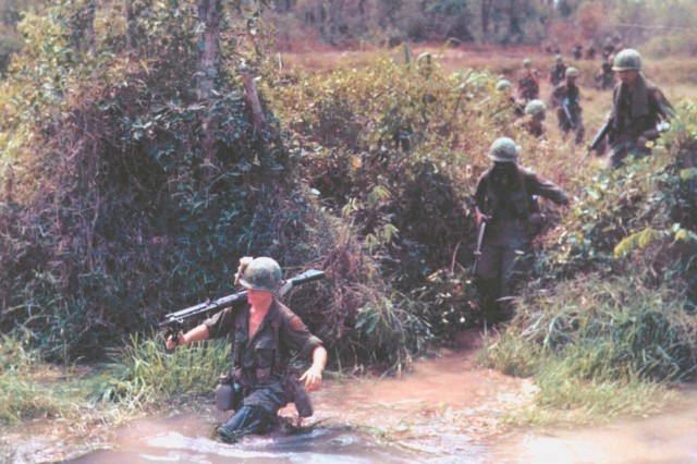 U. S. Army Soldiers of the 1st Infantry Division cross a stream in Vietnam in 1968. U. S. involvement in Vietnam was at its peak when North Korea's Kim Il-Sung decided to wage a low-intensity campaign against U. S. and ROK forces in the late 1960s.