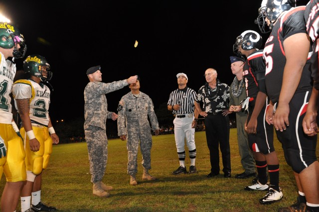 Colonel Bradley Becker, 25th Infantry Division, Deputy Commanding General of Support, and Division Command Sergeant Frank Leota represented the Leilehua High School Mules along with Air Force Colonel, Sam Barrett representing the Radford Rams football team, during the opening coin toss Sept. 24. (U.S. Army photo by Lt. Col. Sean Wilson, 25th Infantry Division Public Affairs Office)