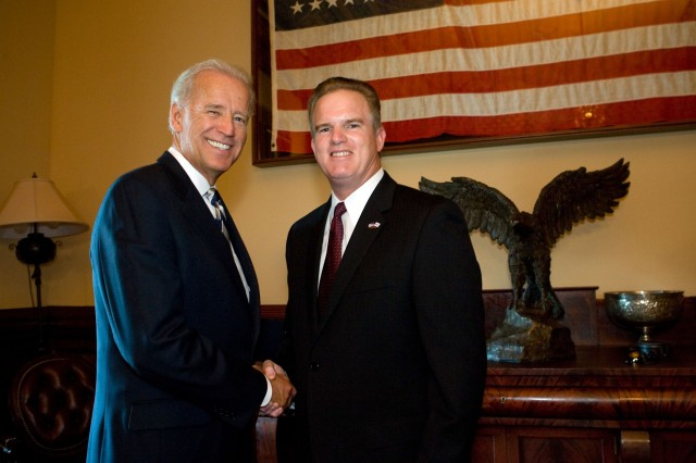 2010 Secretary of Defense Employer Support Freedom Award recipient Bob Ravener, Jr., executive vice president, Dollar General, is congratulated by Vice President Joe Biden Sept. 23, 2010. The Freedom Award is the highest recognition given by the U.S. government to employers for their outstanding support of employees who serve in the National Guard and Reserve. ESGR officials presented the Freedom Awards to 15 recipients in a ceremony in Washington, D.C., the same day. Ravener and the other awardees also met with Secretary of Defense Robert M. Gates the same day.