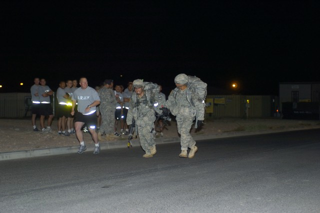 FORT IRWIN, Calif.-Soldiers from the 11th Armored Cavalry Regiment, run the last few feet of a 12-mile ruck march during the final phase of the Expert Infantryman Badge test at the National Training Center on Fort Irwin, Calif., Sept. 24. The ruck march must be completed in less than three hours. (Photo by Sgt. Giancarlo Casem, 11th ACR Public Affairs)