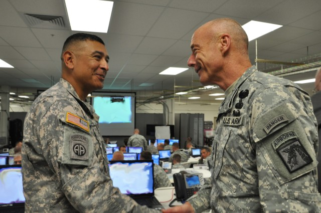 Command Sgt. Maj. Frank M. Leota, 25th Infantry Division, welcomes Lt. Gen. Frank G. Helmick, commanding general, 18th Airborne Corps and Fort Bragg, during his visit to the 1st Lt. Nainoa Hoe Battle Command Training Center, Schofield Barracks, Hawaii, Sept. 27. Helmick received a briefing on the ongoing Mission Readiness Exercise for the upcoming deployment to Iraq.