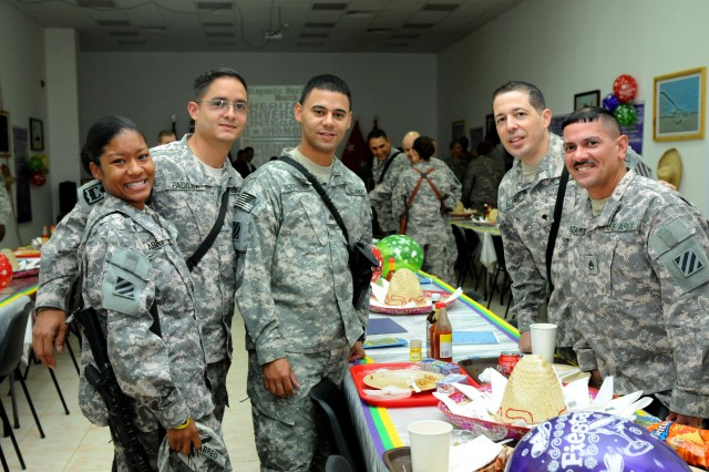 Soldiers with Division Special Troops Battalion, 3rd Infantry Division, pose for a photo after the Hispanic Heritage Month Luncheon, Sept. 25, at Contingency Operating Base Speicher, near Tikrit, Iraq.