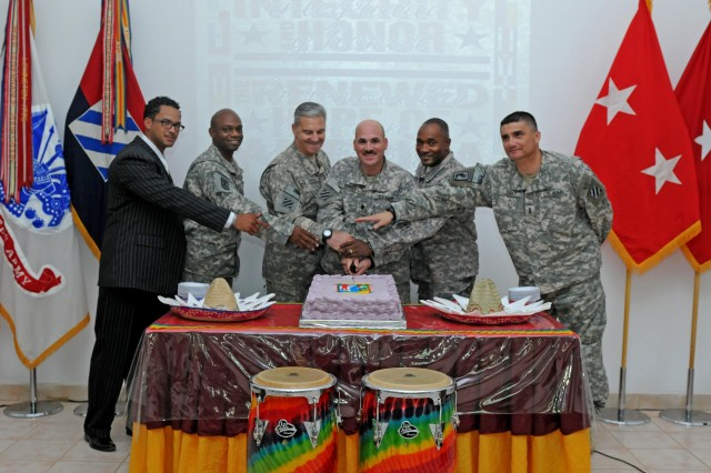 Task Force Marne's Commanding General, Maj. Gen. Tony Cucolo, and Commanding Sergeant Major, Command Sgt. Maj. Jesse Andrews, along with guest speakers, conduct a formal cake cutting at the conclusion of the Hispanic Heritage Month Luncheon, Sept. 25, at Contingency Operating Base Speicher, near Tikrit, Iraq.