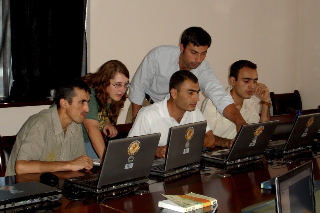 Jennifer Hoban, a GIS specialist from the U.S. Army Corps of Engineers Russellville Project Office in Arkansas, works with representatives from Tajikistan's Committee for Emergency Situations and Civil Defense and Ministry of Defense during a Geographic Information Systems Workshop Aug. 9-13 in Dushanbe. The workshop was sponsored by the USACE Civil Military Emergency Preparedness program.