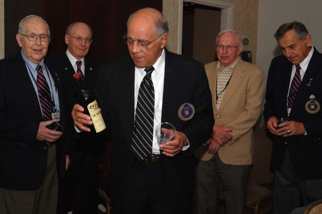 Jesse Oxendine and the remaining WWII veterans of the former 325th Glider Infantry Regiment open a bottle of 1977 apple brandy at the final 325th GIR reunion in Charlotte, Sep. 25. The bottle has been saved for 33 years specifically for the last reunion. (U.S. Army photo by Spc. Kissta M. Feldner, 2BCT PAO)