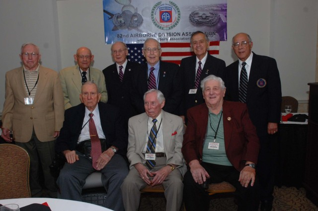 The last remaining members of the WWII unit, the 325th Glider Infantry Regiment, pose in front of the 325th GIR Association banner and the American flag at the conclusion of the final regiment reunion at Charlotte, Sep. 25. Veterans have met annually for the past 30 years. (U.S. Army photo by Spc. Kissta M. Feldner, 2BCT PAO)