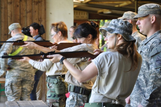 First Armored Division spouses get in some target practice during Combat Spouses Day at the Rheinblick Outdoor Recreation Complex.