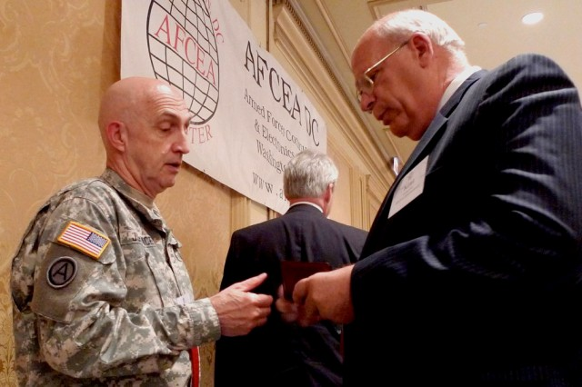 Maj. Gen. Nick Justice, commanding general, RDECOM, exchanges information with an industry member at the National Science Center benefit luncheon in Washington, Sep. 27.
